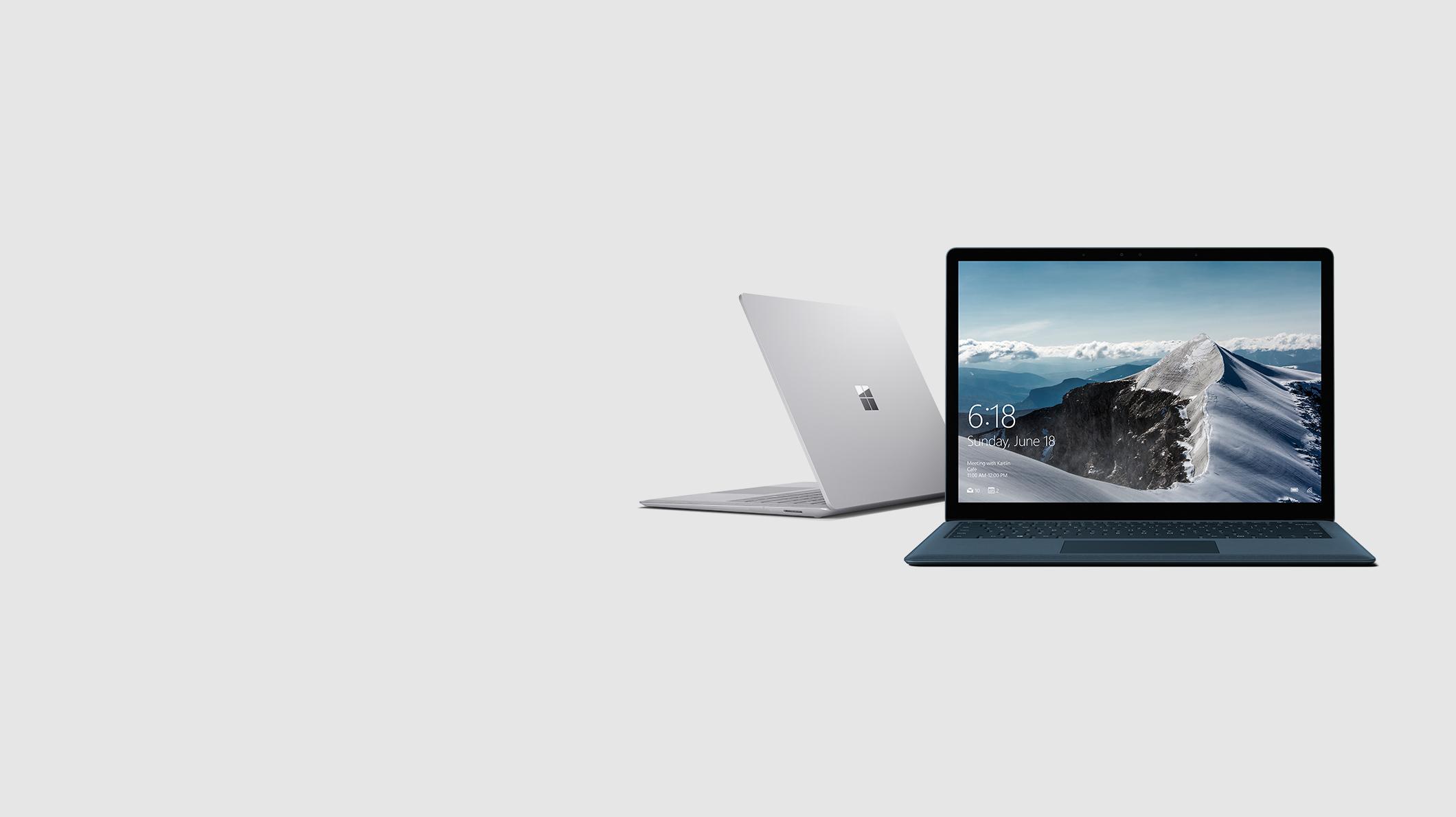 A cobalt Surface Laptop and a platinum Surface Laptop