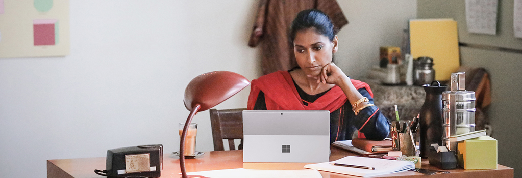 Woman sitting at a desk working on a laptop