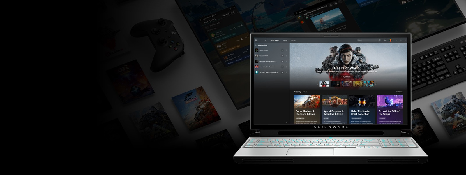 An Alienware laptop sits open with the Xbox app open showing Game Pass for PC and games like Forza Horizon 4, Age of Empires II: Definitive Edition and more.