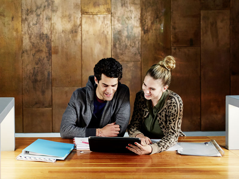 Man and woman looking at a tablet computer