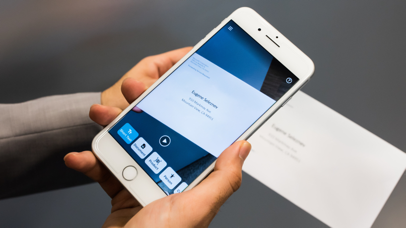 Close up of a smart phone with Seeing AI app set to the Short Text channel and pointing towards an envelope to capture the name and address. Credit: Tyler Mussetter