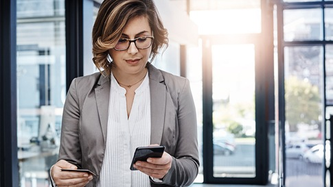 Woman looking down at mobile device