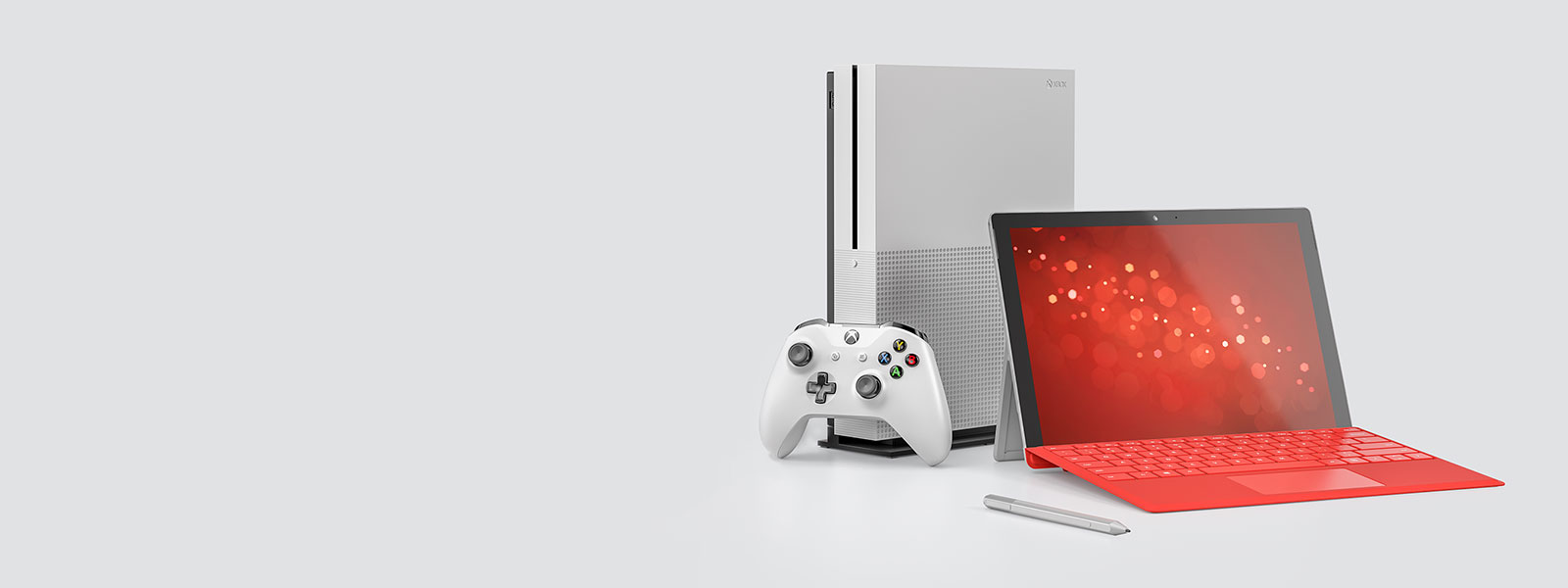 A Surface device, a Surface Pen, and an Xbox One S