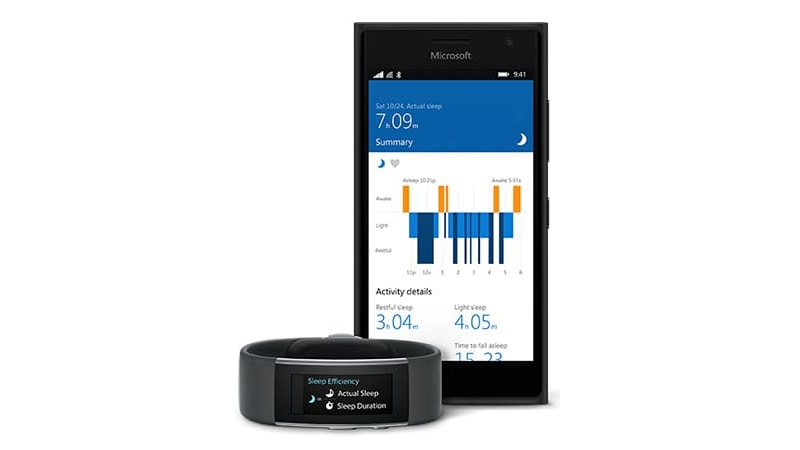 microsoft lumia phone with microsoft band in front of it and a sleep monitor data open
