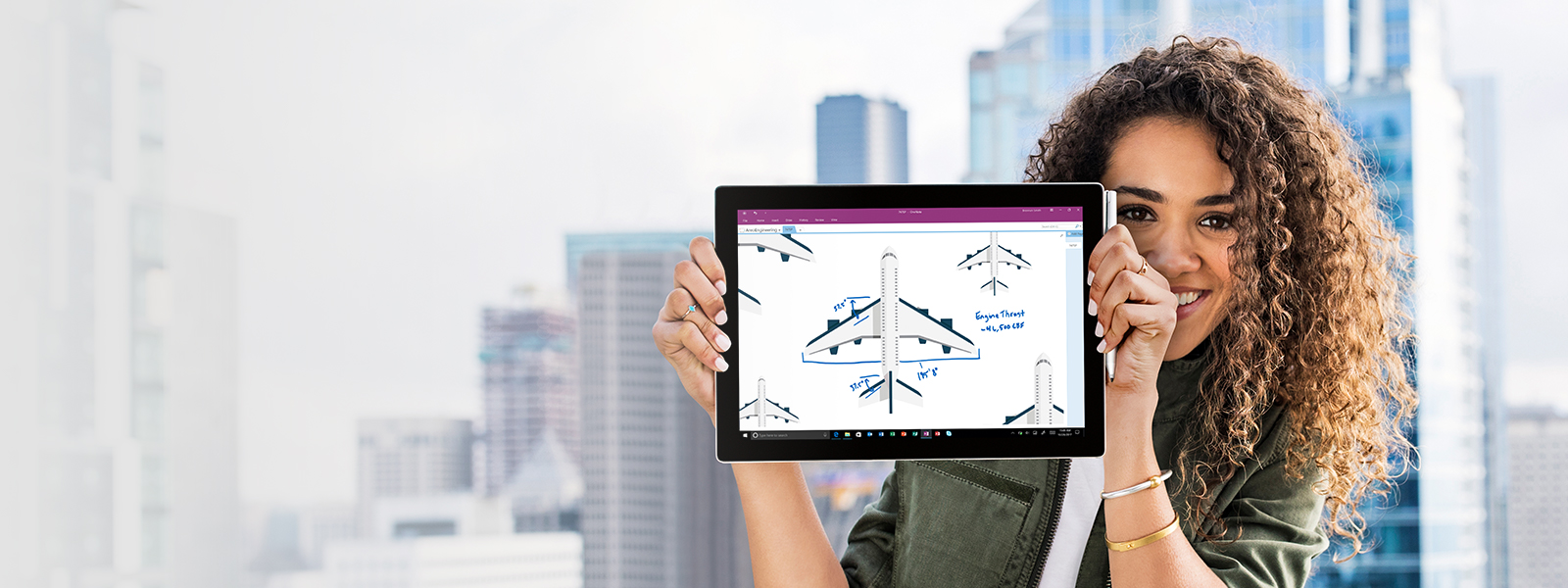 A woman holding a tablet with a plane diagram on the screen