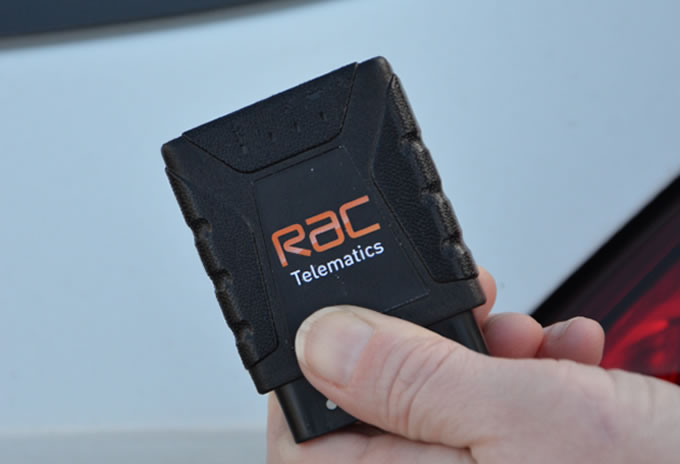 A person holding a telematics device.