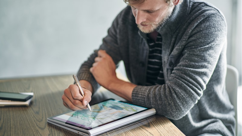 Man writing on tablet with pen