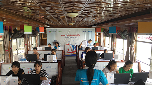 Students involved in the Enabling Boat project by Khoa Pham in Vietnam