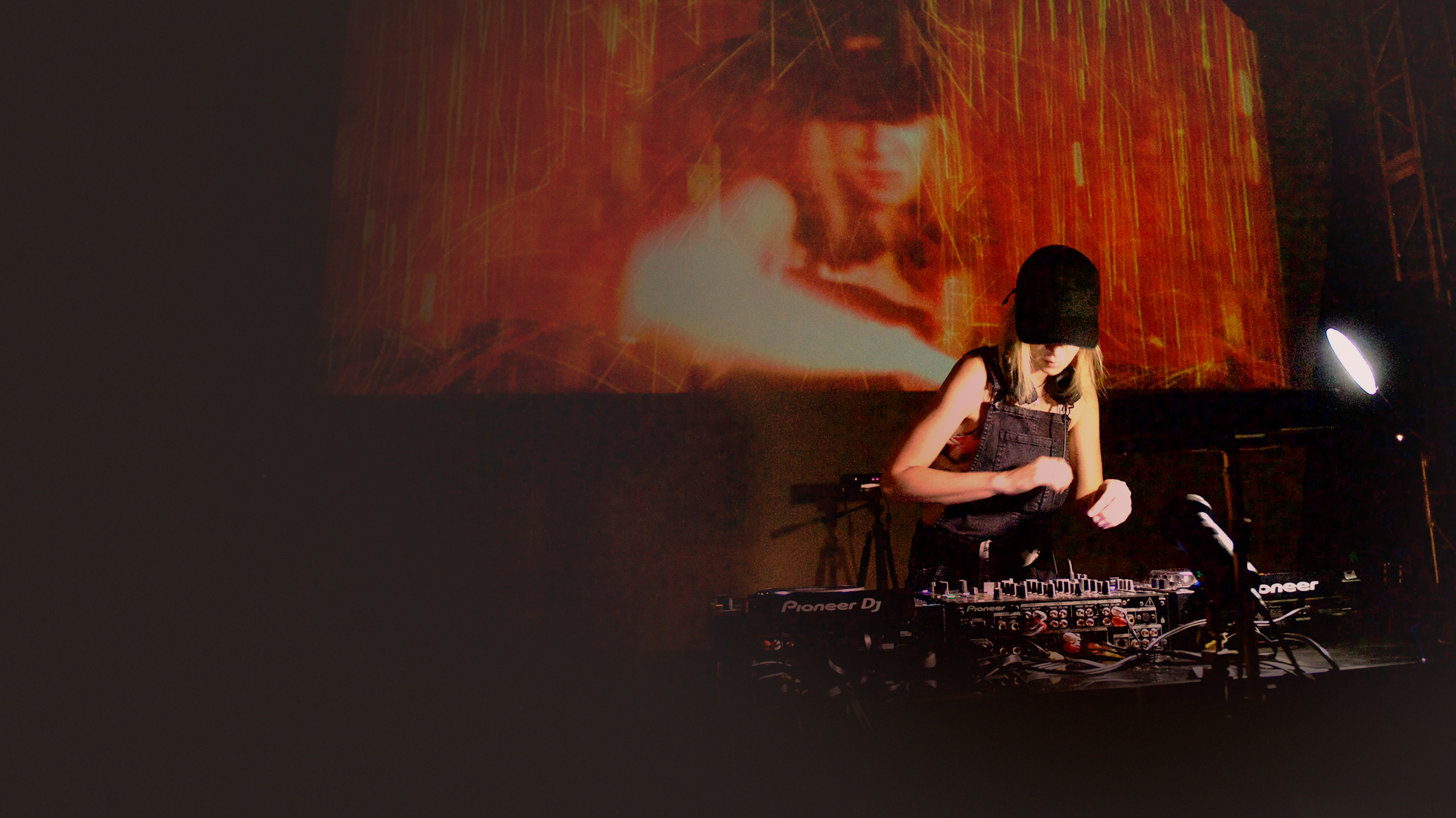Alison Wonderland performs as her enhanced image is projected on a large screen