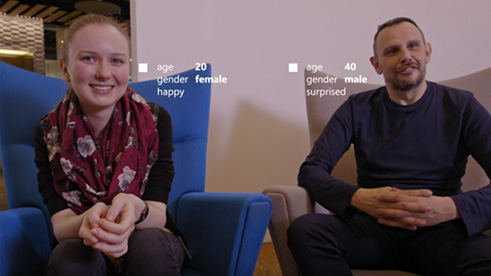 Man and woman seen through Microsoft Cognitive Service API with gender and age labels