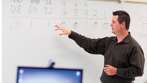 A TEALS volunteer teaching computer science in a school