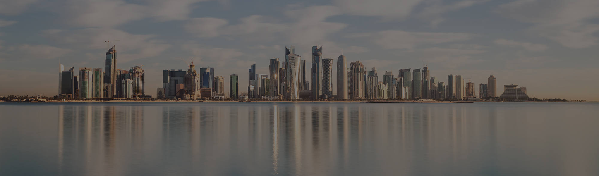 View of city skyline along coastal waterfront