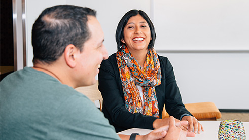 Employees laughing in meeting