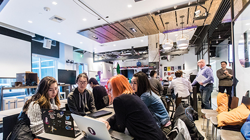 Microsoft employees use devices at One Week Hackathon