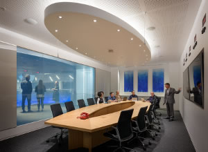 Image of meeting in progress inside a conference room