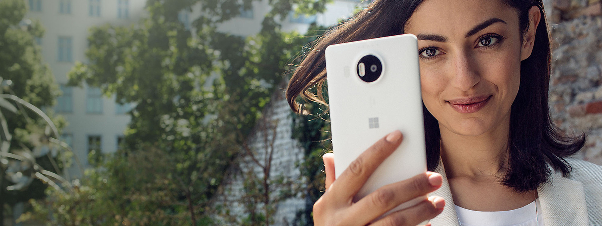 Woman looking at her Lumia 950 XL
