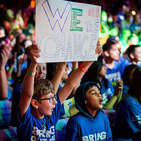 Students cheering for WE during a WE Day event