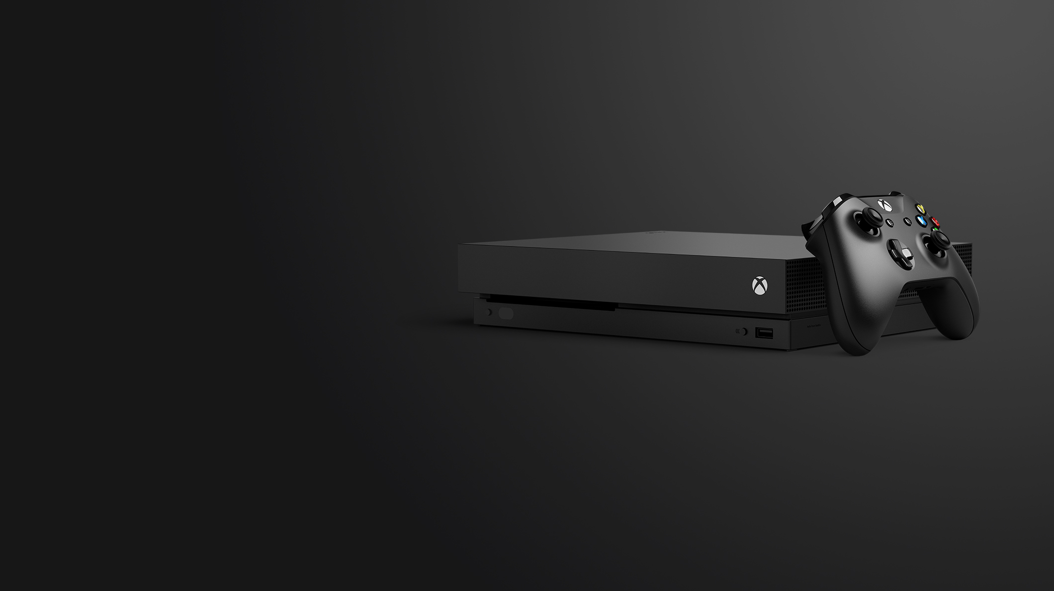 An Xbox One X with controller