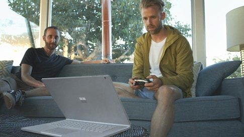 People playing video games on their Surface device