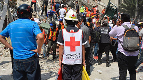 Relief workers gather to provide support after the 2017 Mexico earthquake