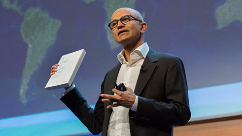 Satya Nadella holding a Cloud for Global Good book