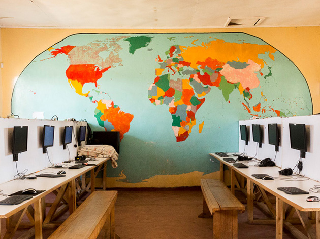 World map on wall in room with computers