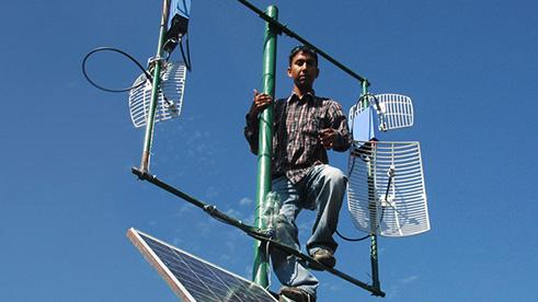 Man standing on broadband radio tower