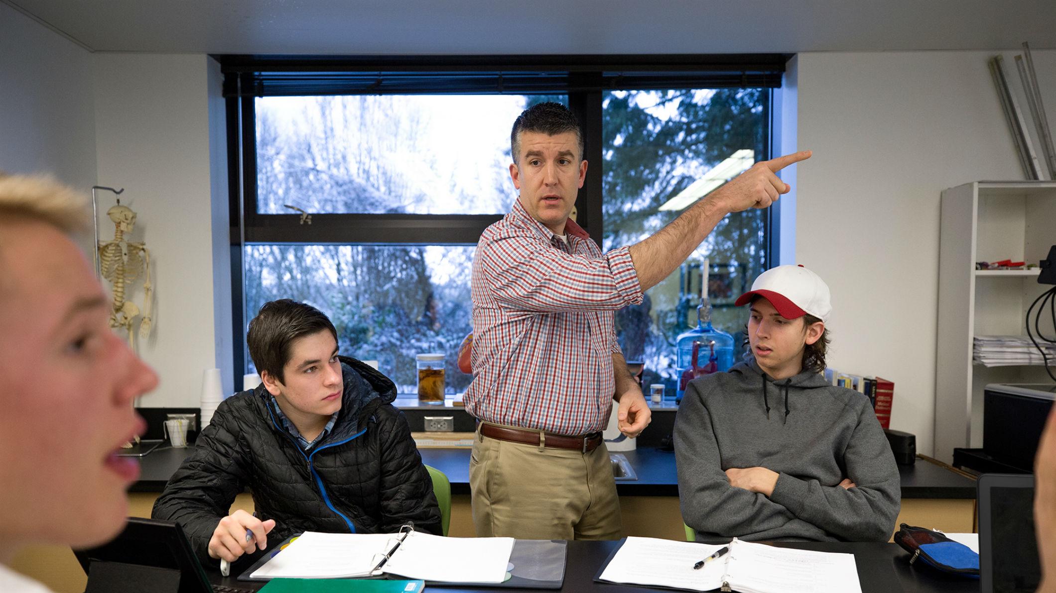 A teacher teaching CS to students