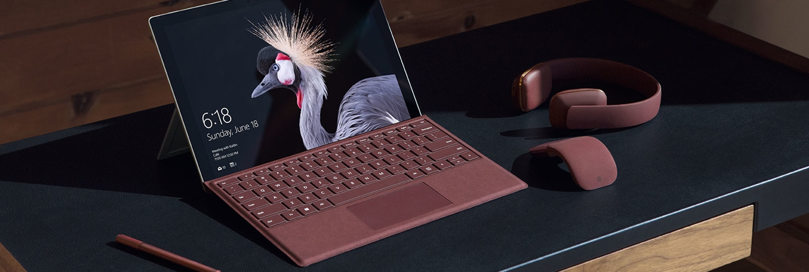 Surface Pro, Surface Mouse, and Surface Pen on a desk