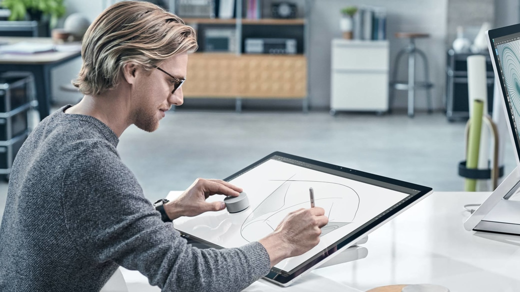 A person using a Surface Dial