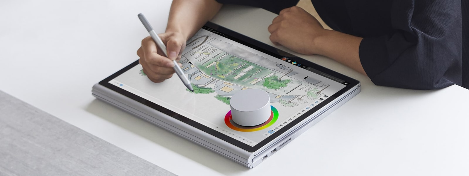 An artist using a Surface Dial to adjust colors