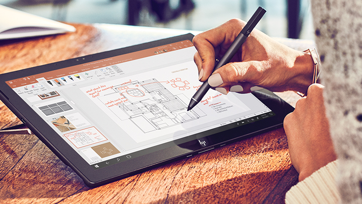 A digital pen touches a diagram on a tablet screen