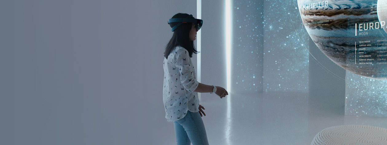 Young girl viewing a projection of the solar system through a HoloLens