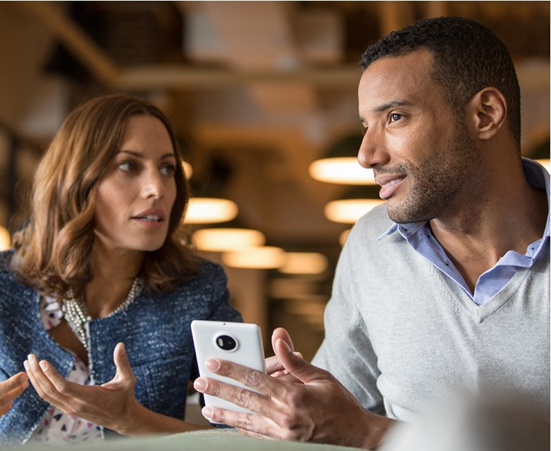 2 People talking over a smartphone