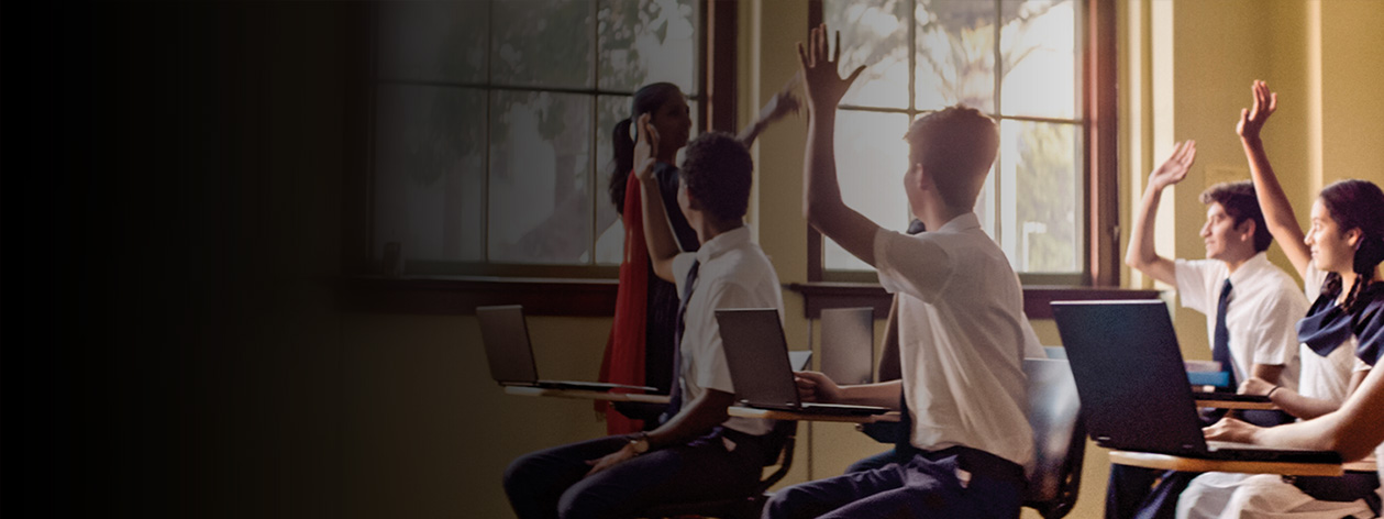 Students and teacher interacting in a classroom setting