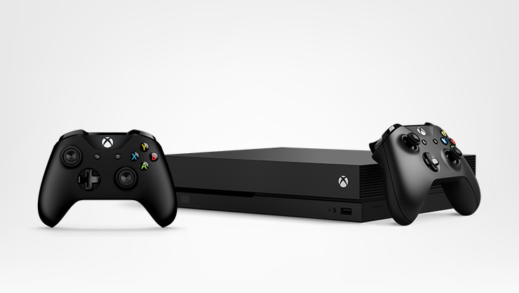 Xbox One X with two Xbox One controllers