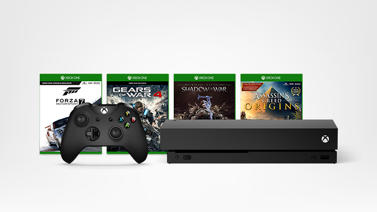 Xbox One X with black controller and four Xbox One games
