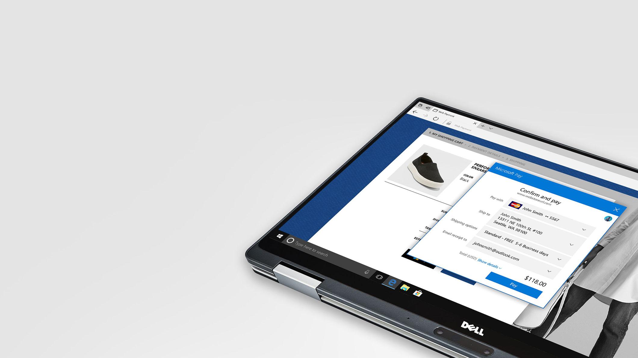 A laptop screen displays an online checkout form