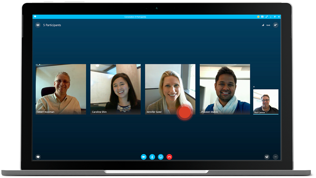 Laptop showing Skype for Business meeting in progress, with images of each participant and a red dot hovering over one of them