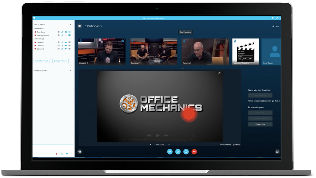 Laptop showing Skype meeting with multiple camera views and a red dot over the screen broadcasting the meeting