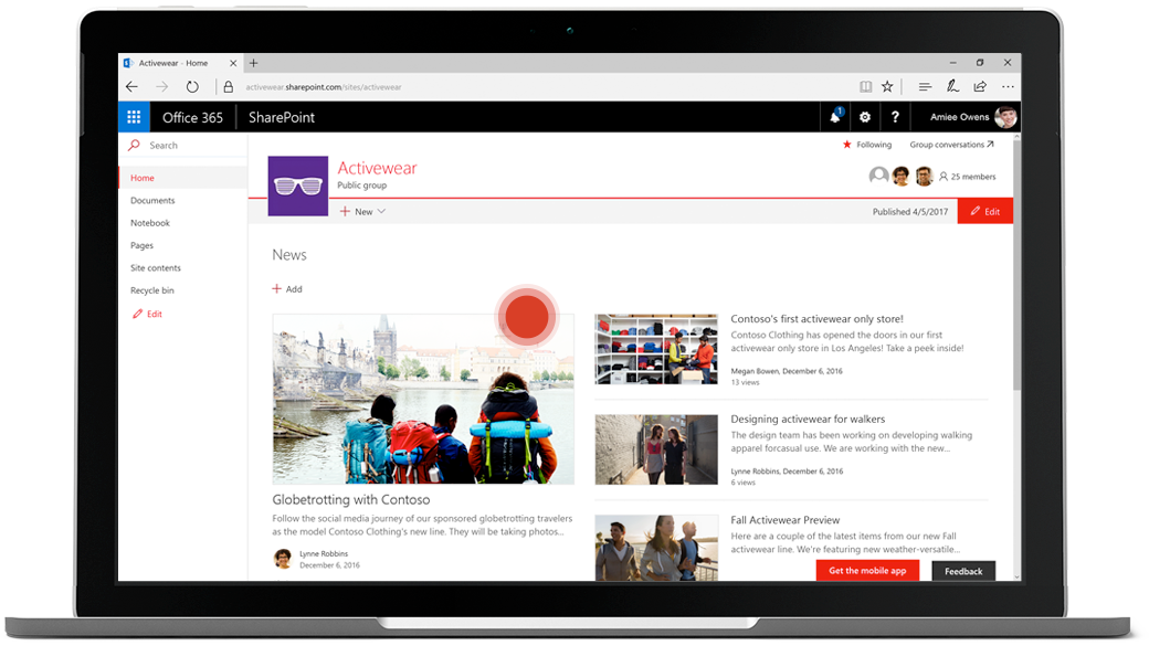 Laptop showing SharePoint team site for news, with a red dot on an article