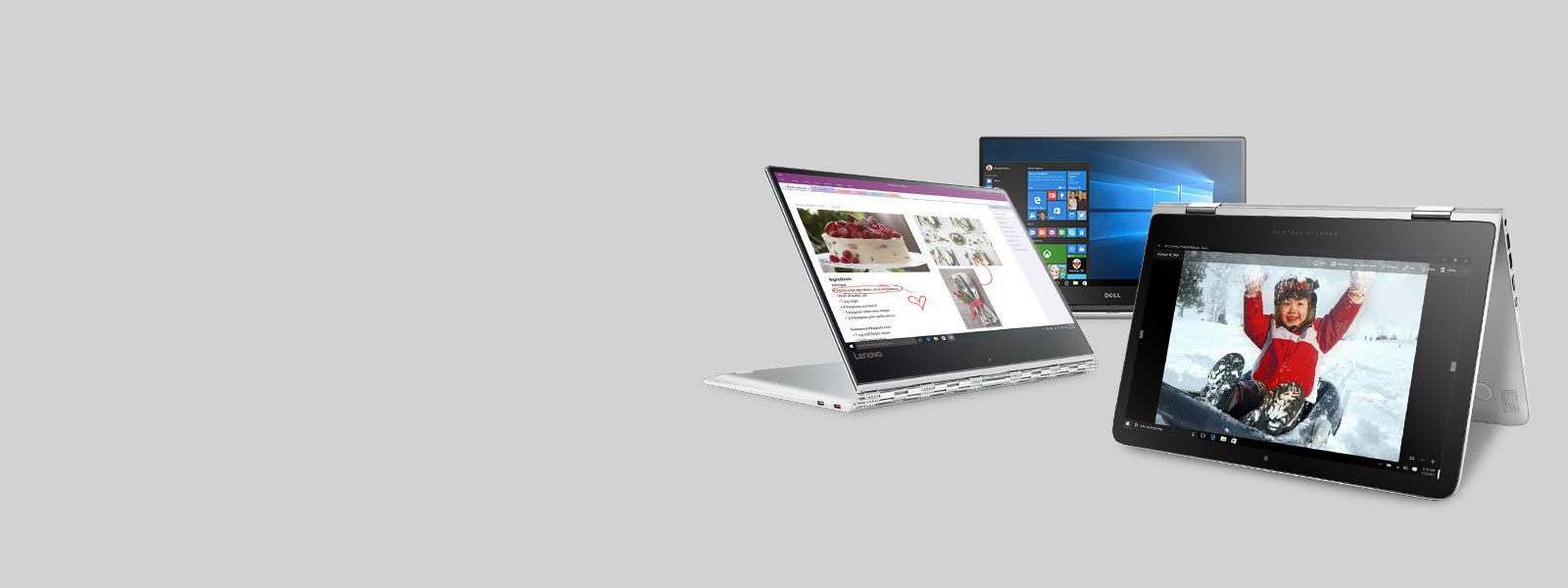 A Lenovo Yoga 910 laptop, an HP Spectre x360 laptop, and a Dell XPS 13 laptop