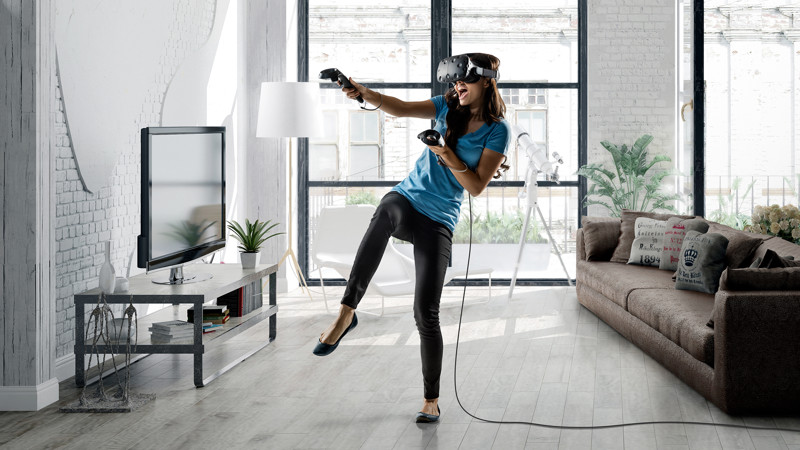 Woman playing HTC Vive in living room