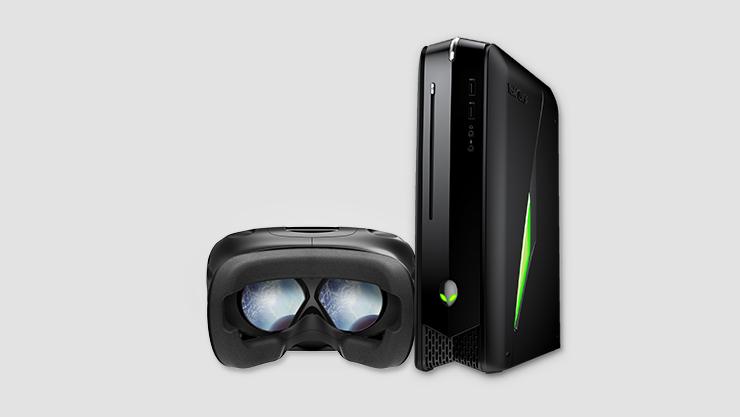 Virtual reality headset sitting next to Dell Alienware pc tower. | Casque de réalité virtuelle déposé à côté d'une tour de PC Dell Alienware.