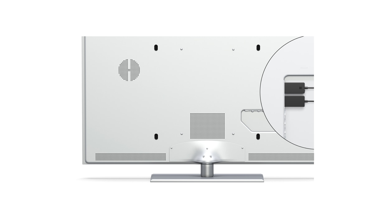 Microsoft Wireless Display Adapter connected to a display's HDMI and USB inputs.