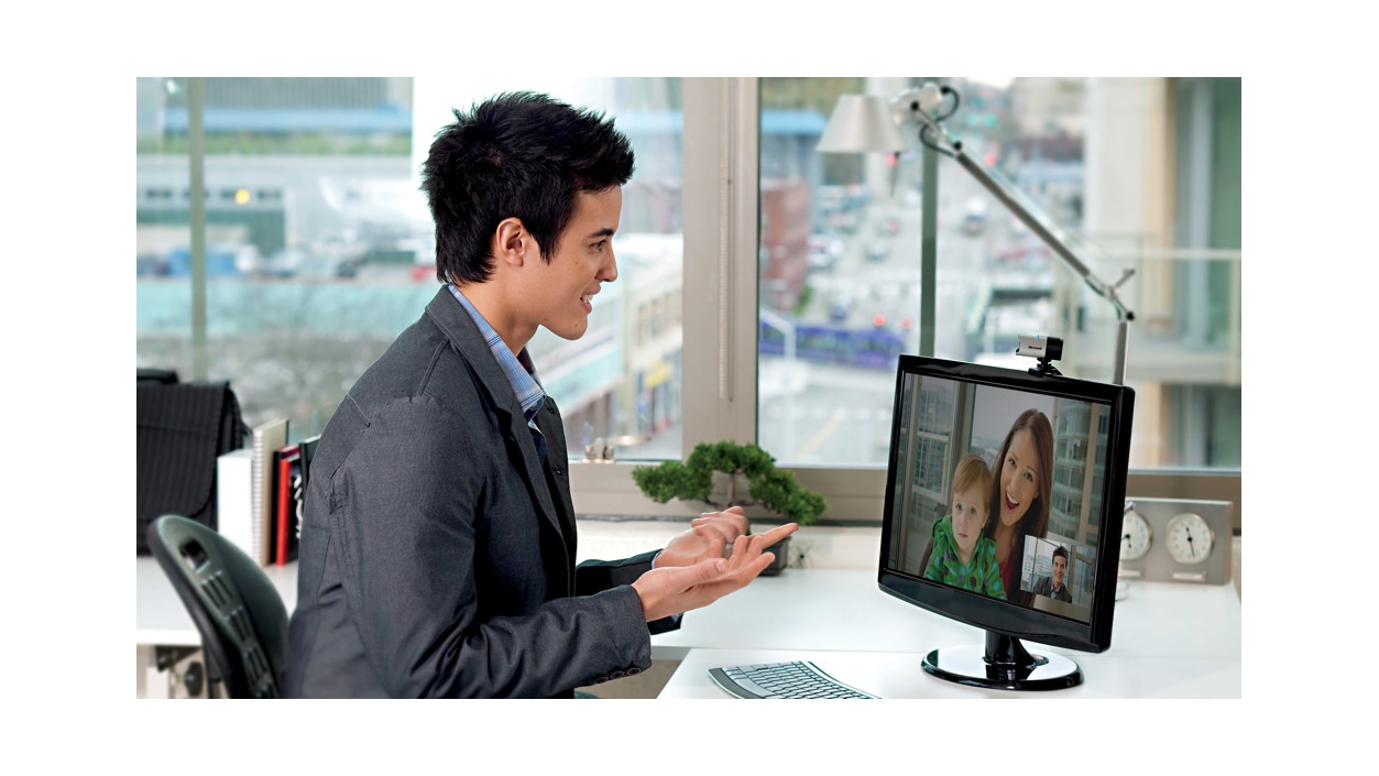 A person video chatting with their family using the LifeCam Studio.