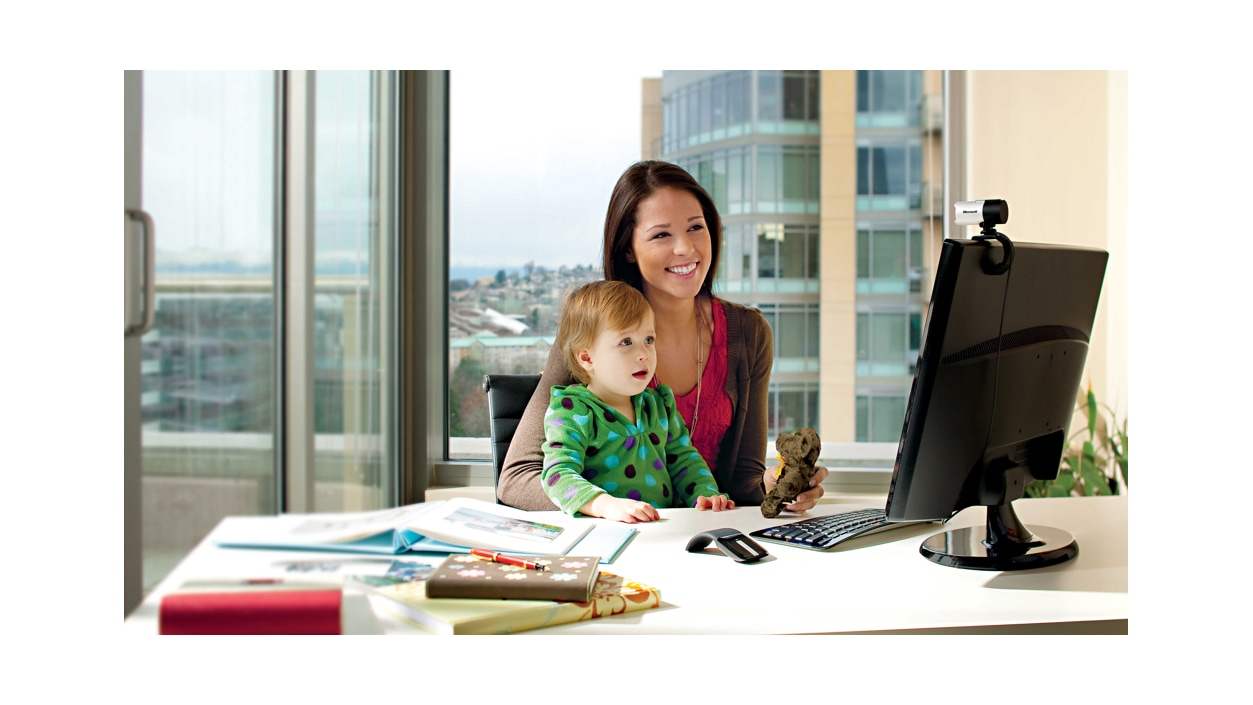 A family chatting on the computer using the LifeCam Studio.