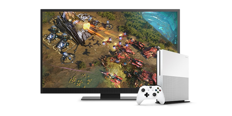 Monitor with game screenshot and Xbox with controller.