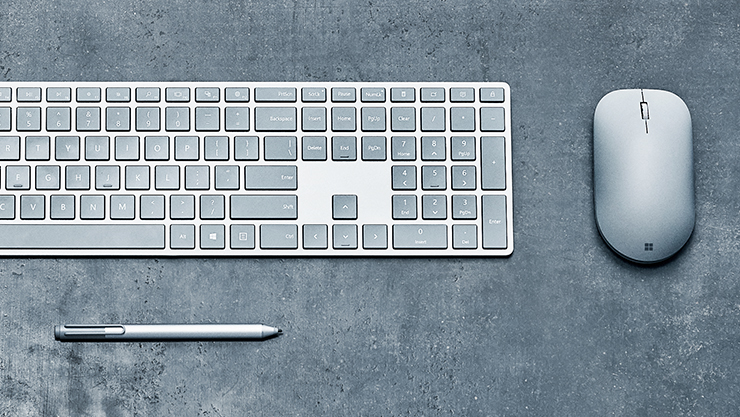A Surface keyboard with a surface mouse and a surface pen.