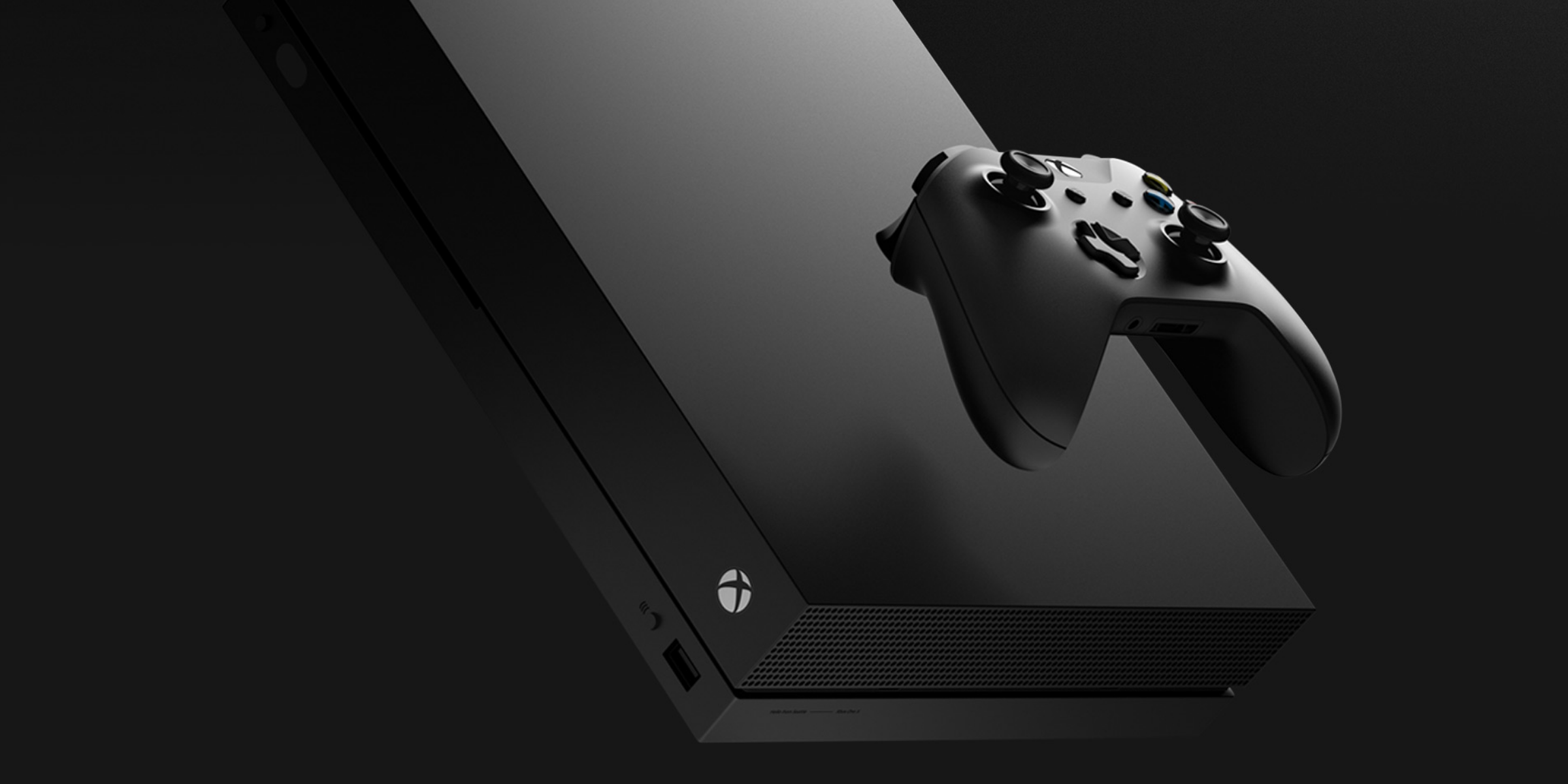 Xbox One X console floating with a controller